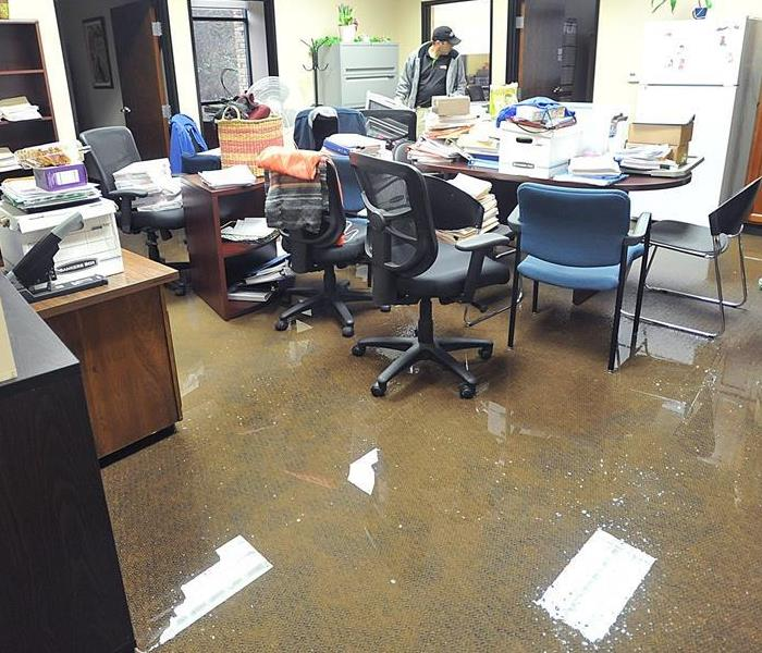 An office is flooded with 4 inches of water