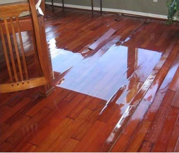 Buckled hard wood floors due to water damage
