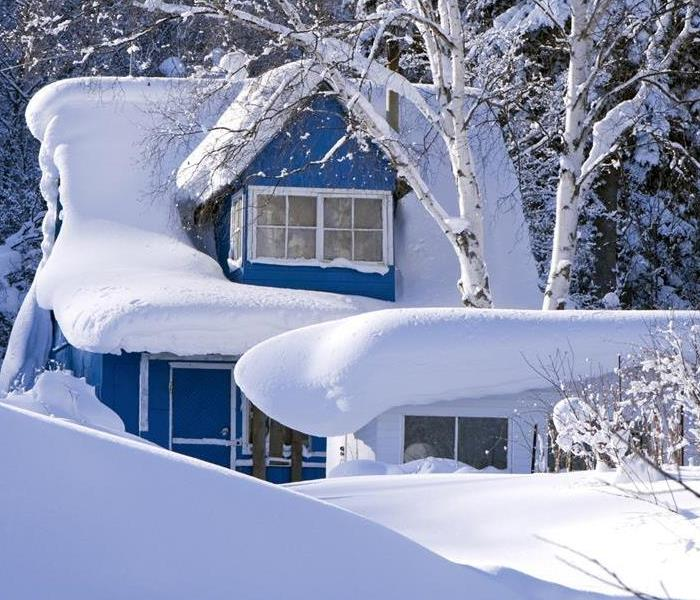 a home covered in a blanket of snow